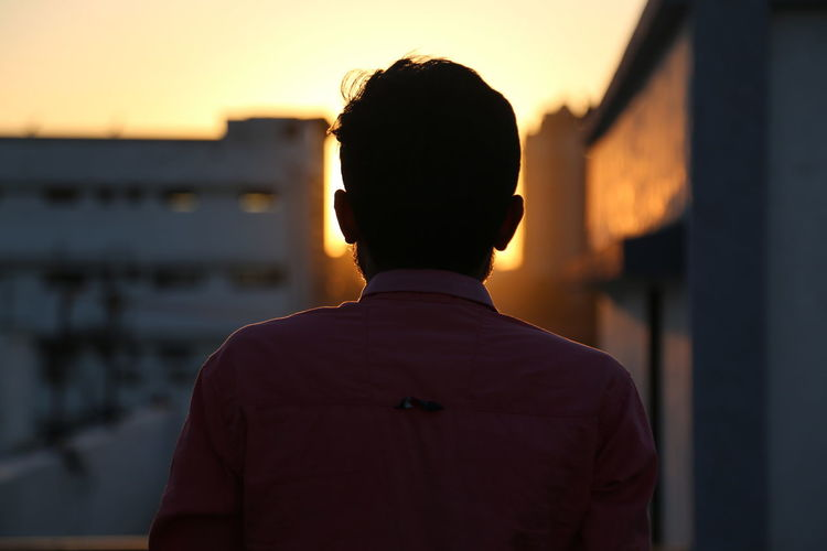 Rear View Men Sunset Focus On Foreground One Person Real People Architecture Built Structure Building Exterior Headshot Portrait Sky Standing Lifestyles Outdoors Leisure Activity Silhouette Nature City The Art Of Street Photography Exploring Fun My Best Photo The Portraitist - 2019 EyeEm Awards The Minimalist - 2019 EyeEm Awards