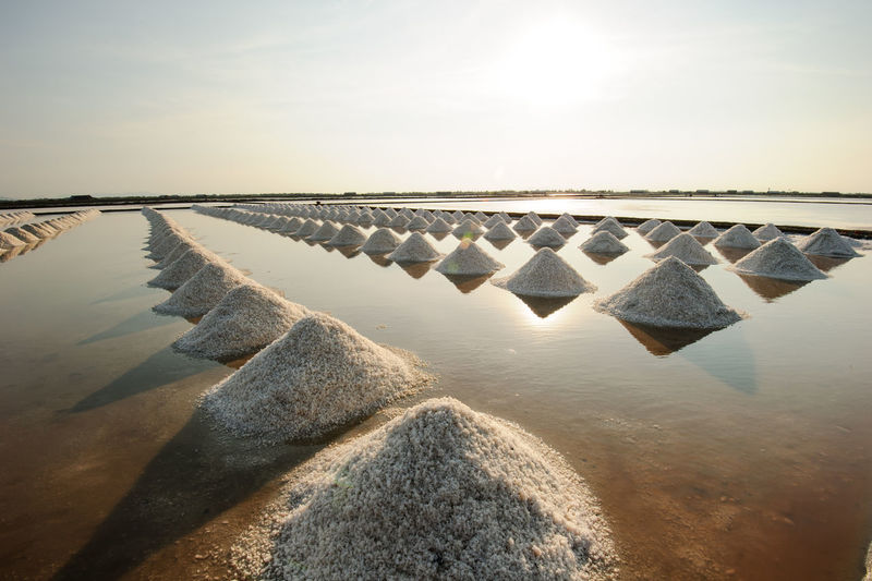 Beauty In Nature Concrete Day Groyne Horizon Horizon Over Water In A Row Land Mineral Nature No People Outdoors Rock Salt - Mineral Salt Flat Scenics - Nature Sea Sky Solid Sunlight Tranquil Scene Tranquility Water