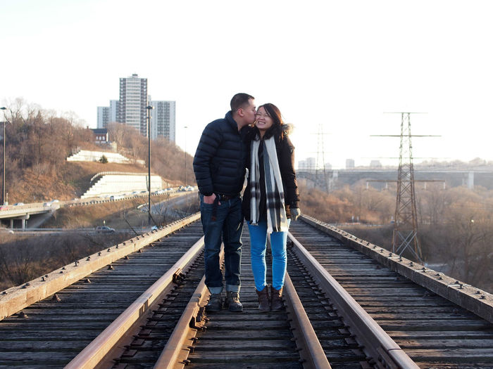 People standing on railroad track