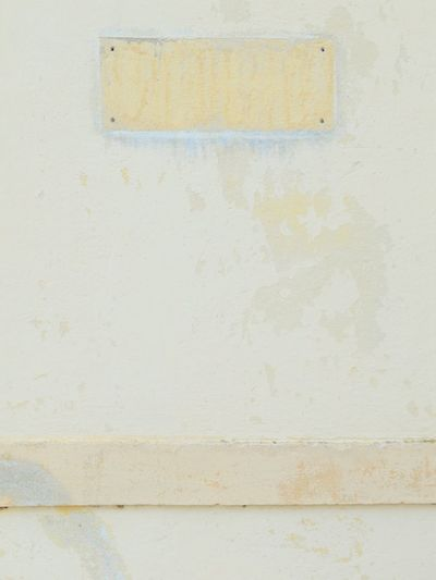 Textures And Surfaces Background ArchiTexture Yellow Beige Cream Concrete Wall Scratched Plaster Rectangle Shape Four Holes For Plaque Weathered Wall Stained