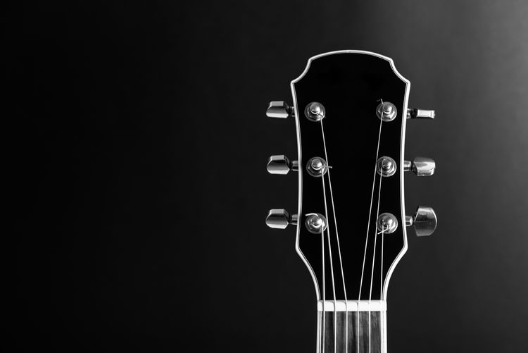 If I was a guitar teacher I'd definitely be using this shot as my business card! || Copy Space EyeEm Best Shots Fretboard Music Acoustic Guitar Black And White Black Background Close-up Day Electric Guitar Guitar Headstock Indoors  Light And Shadow Lines And Shapes Musical Instrument Musical Instrument String No People Product Photography Studio Shot Tuning Pegs