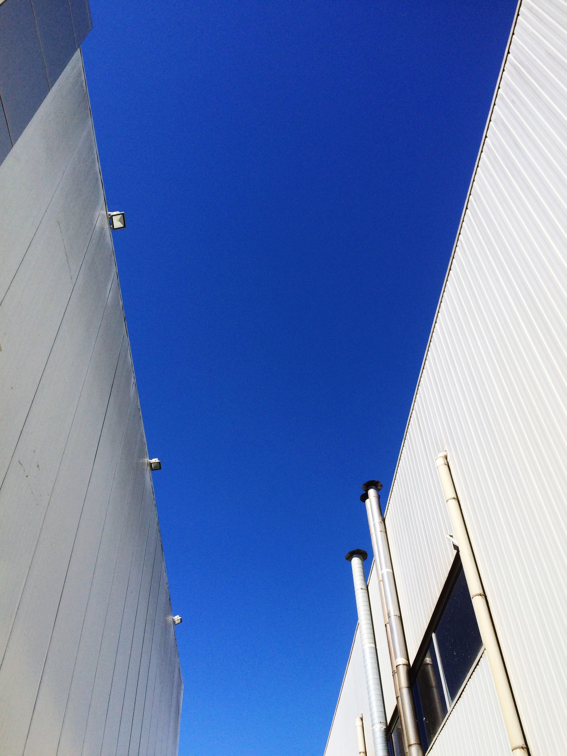 low angle view, blue, architecture, building exterior, built structure, clear sky, day, outdoors, no people