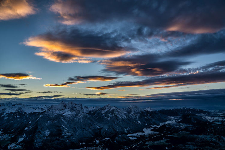 Scenic View Of Snowcapped Mountains Against Dramatic Sky