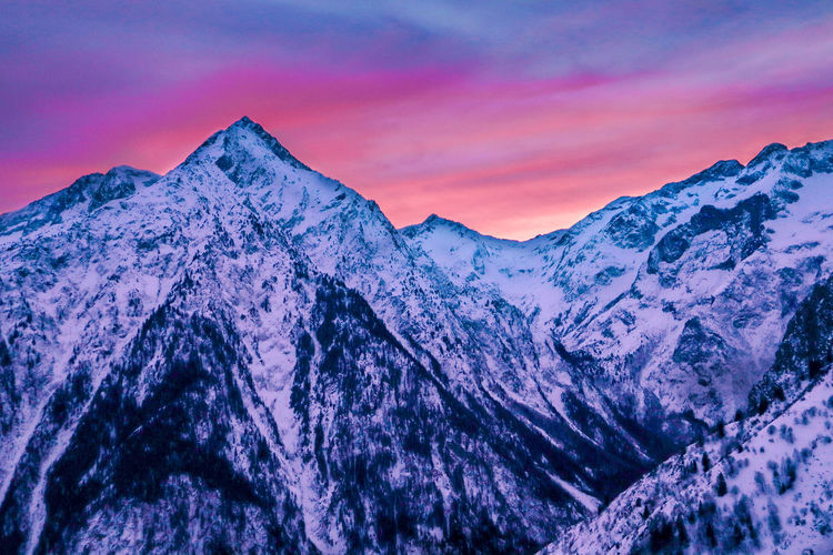 A beautiful sunset in a really outstanding mountain environment. Mountain Sunset Mountain View Beauty In Nature Snow Cloud - Sky Winter Mountain Peak Purple Snowcapped Mountain Idyllic Environment Mountain Range No People Formation Nature Cold Temperature Non-urban Scene