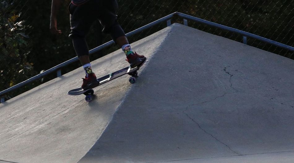 Over the top. Concrete Skateboard Skate Park JGLowe Real People Sport Lifestyles Day People Leisure Activity Nature High Angle View City Sunlight Skill  Shadow Outdoors Ride Riding