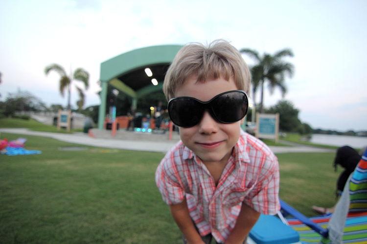 Boy wearing sunglasses on field