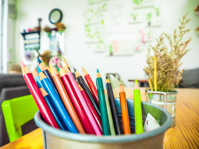 Multicolored pencils are combined in a steel box on a desk in the office. Art Background Blue Bright Brown Closeup College Color Colored Colorful Colors Colour Concept Crayon Crayons Creative Design Draw Drawing Education Equipment Frame Green Group Image Isolated Macro Object Office Orange Paint Palette Pen Pencil Pencils Rainbow Red Row School Set Sharp Stationery Supplies Up Variation Vector White Wood Wooden Yellow Multi Colored Still Life Indoors  No People Table Writing Instrument Large Group Of Objects Art And Craft Close-up Choice Focus On Foreground Craft Creativity Colored Pencil Collection Container Art And Craft Equipment