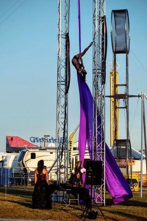 Nebraska State Fair August 2016 Grand Island, Nebraska -- Flippin' - A Steam Punk Theme Aerial & Acrobatic Spectactular Acrobat Acrobatics  Action Shot  Balancing Act Camera Work Check This Out Clear Sky Costume Daredevil Death Defying EyeEm Gallery Nebraska Outdoors Performance Performing Arts Photography Photojournalism Splits State Fair Steam Punk Stunts Stuntshow Trapeze Artist Unrecognizable Person Upsidedown