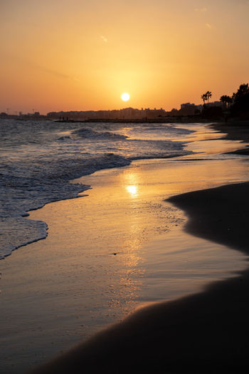 Sunset Sky Water Beach Land Sea Beauty In Nature Nature Scenics - Nature Sun Reflection Tranquility Tranquil Scene Sand Orange Color Sunlight Idyllic Outdoors Holiday No People Limassol Cyprus