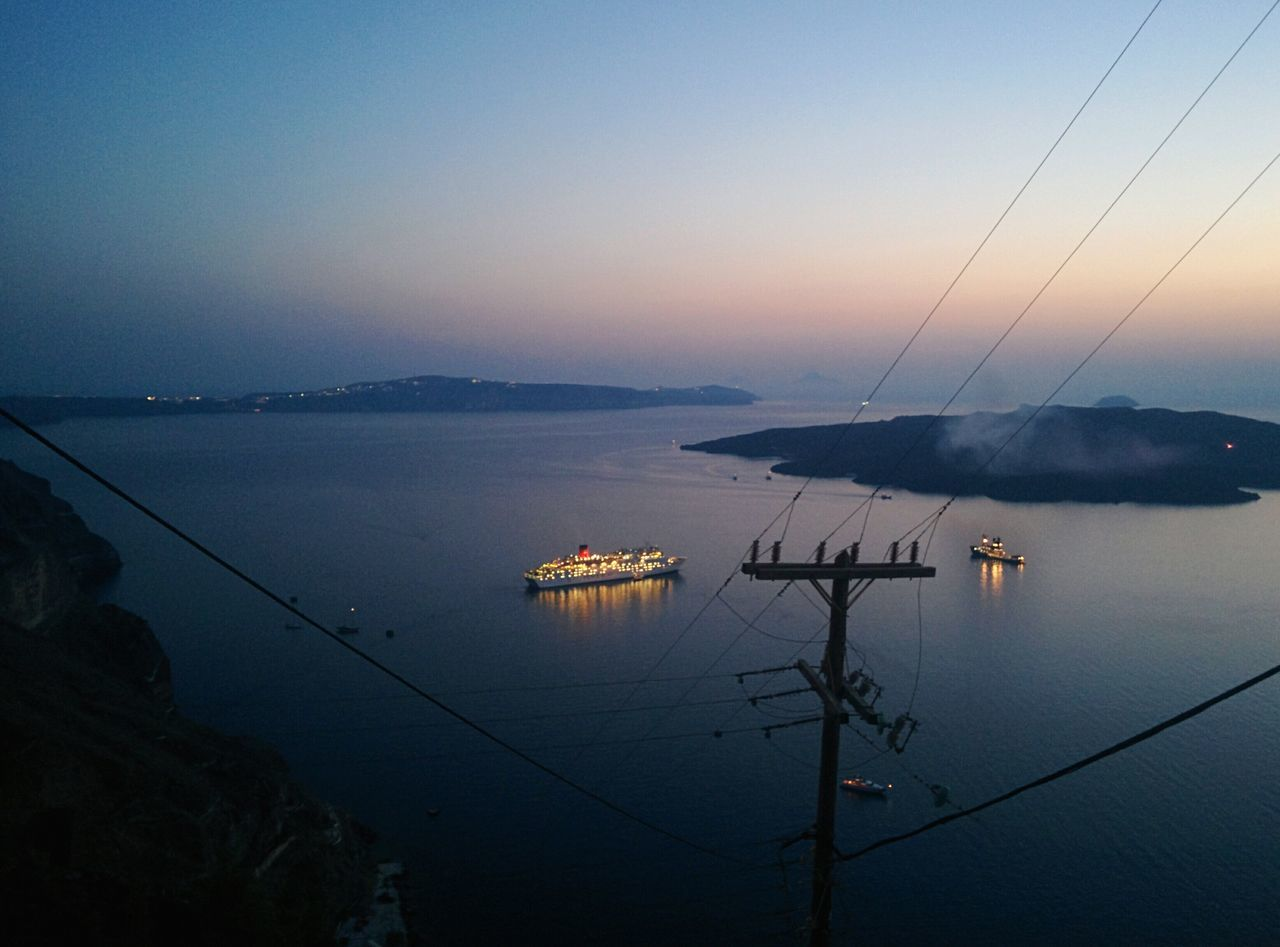 🇬🇷 Greece View From Above Bird's Eye View Ship Holiday POV Water Sea Nautical Vessel Sunset Santorini Dusk Scenics Tranquility Mode Of Transport Tranquil Scene Cable Harbor Ship Nature Sky Beauty In Nature Non-urban Scene Journey Blue Steel Cable Finding New Frontiers Go Higher