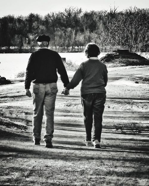 Two People Togetherness Rear View Real People Love Bonding Standing Full Length Friendship Nature Water People Outdoors Walking Holding Hands Black And White Bw Older Couple True Love Married Together Forever