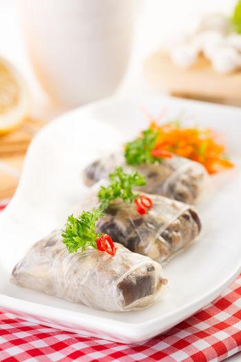 Close-up of ravioli in plate on napkin