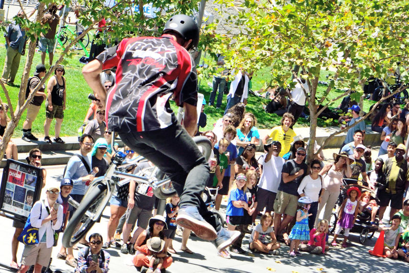 Bmx Jumpers 8 Bmx Pros Trick Team Peddle Fest @ Jack London Square Oakland, Ca. Bicycle Stunt Riders Stunt Show Extreme Stunts Acrobatic Stunts Freestyle Sports Action Sports Sports In The City Urban Sports Owner-operator : Woody Itson Former Bmx Freestyle Champion People Watching