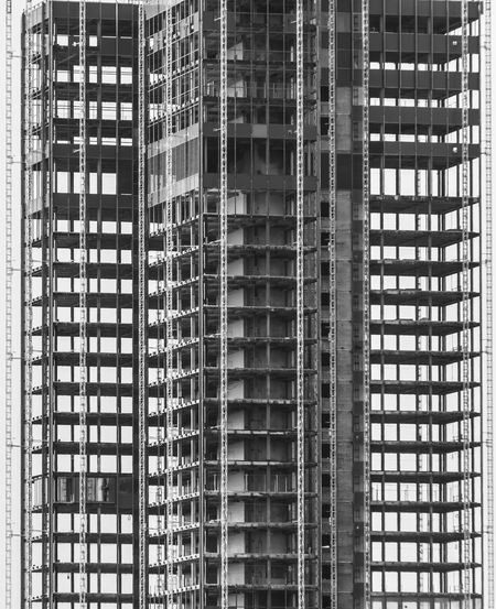 Low angle view of modern  building under construction in city