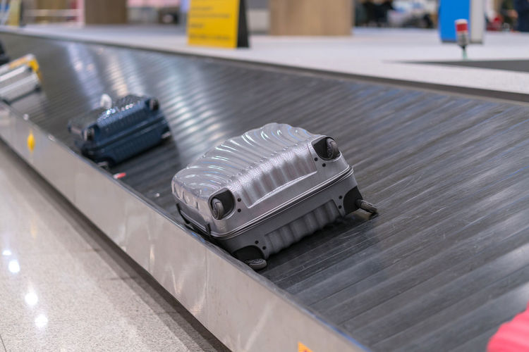 Close-up of luggage on conveyor belt in airport