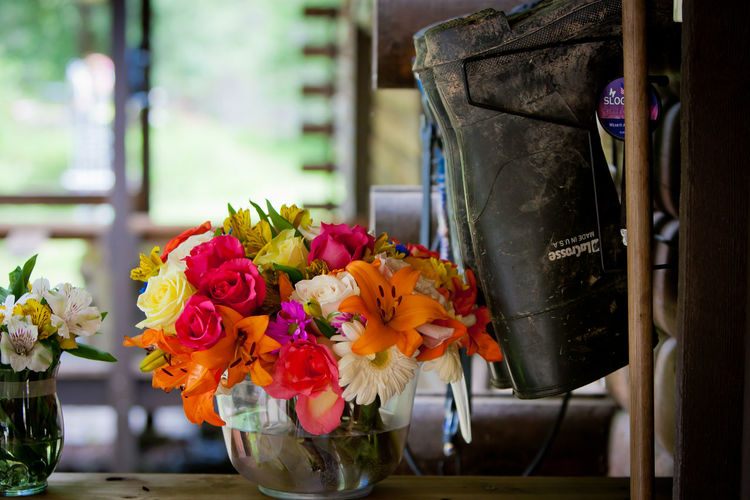 Colorful Flowers In Vases By Rubber Boot