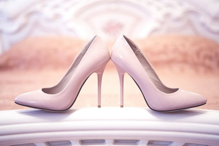 Close-up of high heels stilettos on bed at home