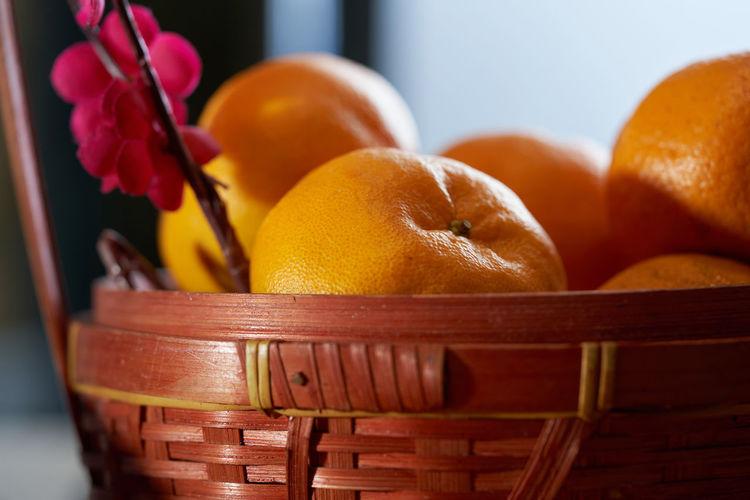 Close-up of orange fruits in basket