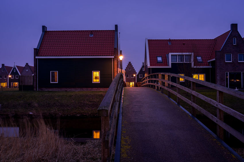 Architecture Building Building Exterior Built Structure City Clear Sky Direction Dusk House Illuminated Nature Night No People Outdoors Residential District Sky Transportation Water Wood - Material