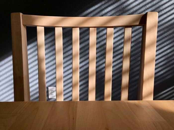High angle view of blinds on hardwood floor