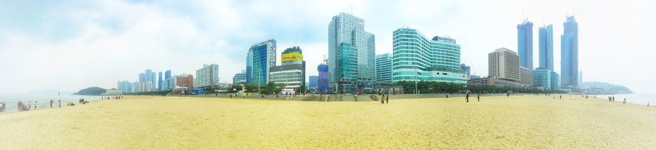 A panoramic view of Haeundae Beach at Busan in South Korea. Seaside Tourism Travel Skyscrapers South Korea Haeundae Busan Sandy Sand Beach Built Structure Sky Architecture Building Exterior Skyscraper City Office Building Exterior Tall - High Building Panoramic Nature Landscape Office Urban Skyline Cloud - Sky Modern Land Beach Incidental People Day