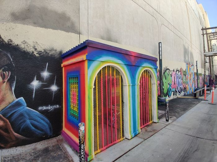 Low angle view of multi colored building on street in city