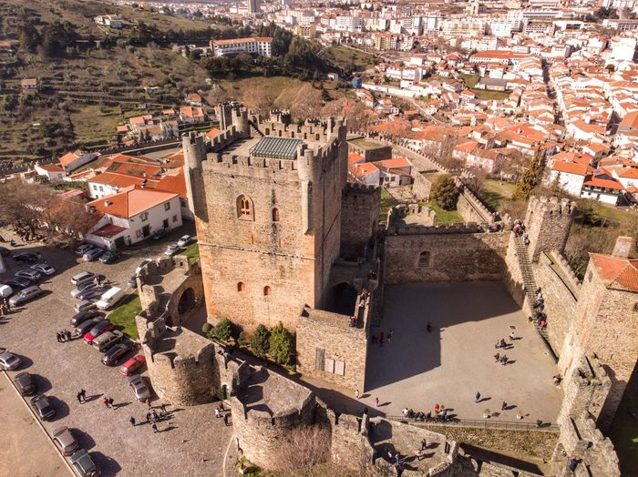 Bragança Castle farol above DJI X Eyeem DJI Mavic Air Drone Photograph Architecture High Angle View Building Sunlight City Nature Crowd Town Outdoors House Residential District Day Built Structure Building Exterior Roof Crowded Incidental People Plant Land Cityscape