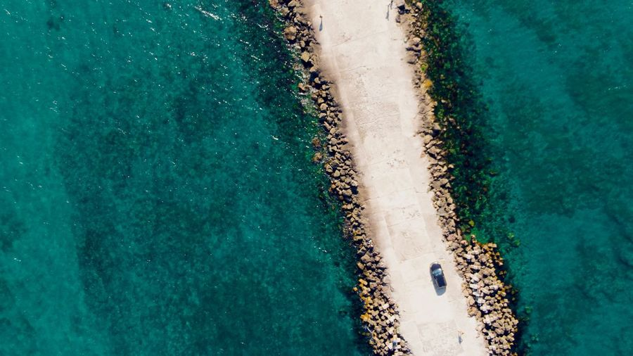 Aerial View Of Road Amidst Sea