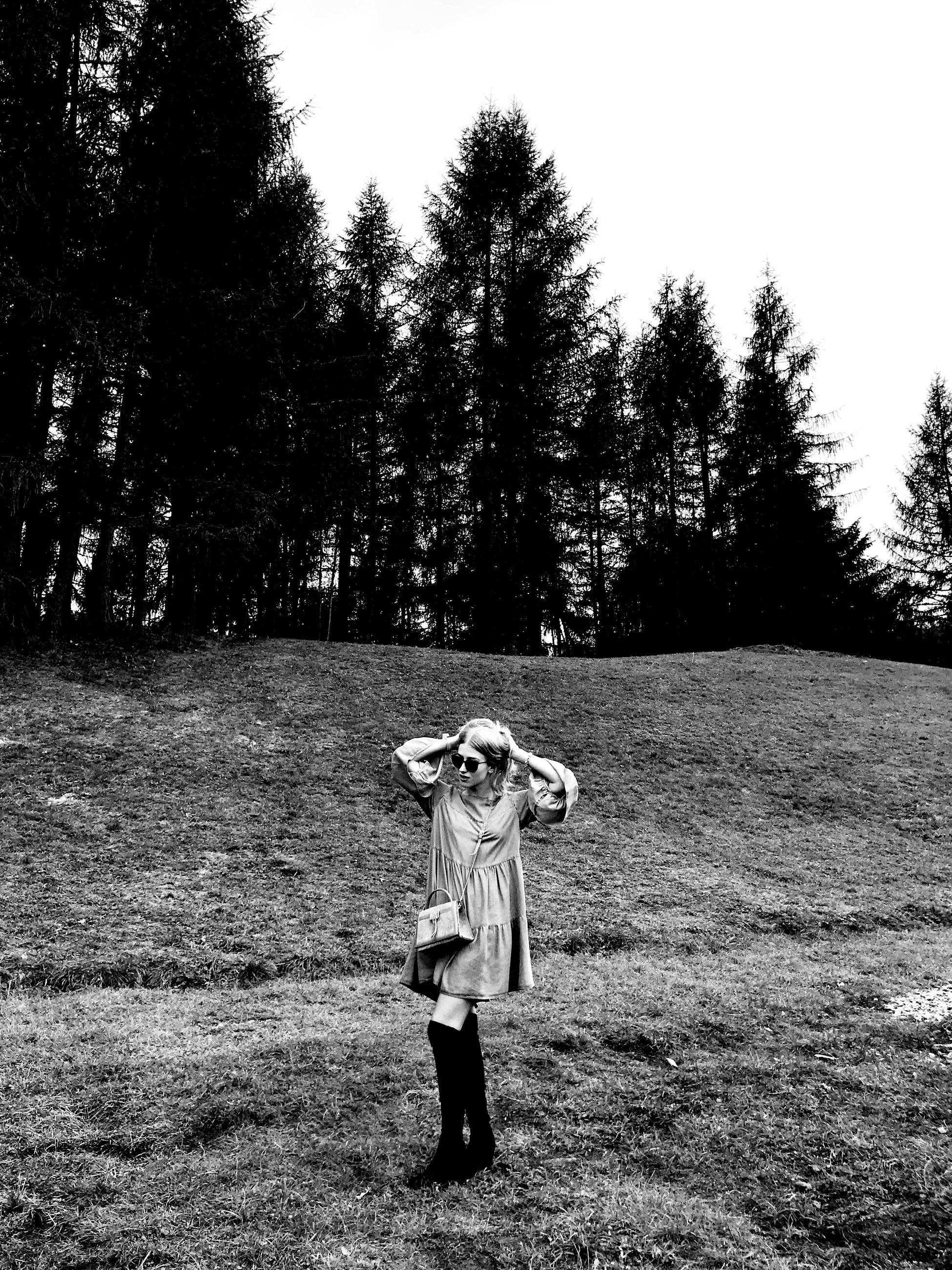 tree, plant, land, real people, one person, child, field, front view, standing, leisure activity, childhood, lifestyles, nature, girls, day, casual clothing, full length, grass, growth, human arm, teenager, innocence