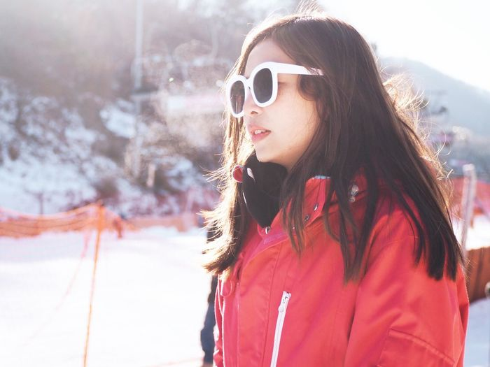 Sunglasses One Person Glasses Young Adult Young Women Leisure Activity Long Hair Real People Winter Fashion Focus On Foreground Snow Lifestyles Day Cold Temperature Hairstyle Women Waist Up Hair Portrait Beautiful Woman Outdoors Warm Clothing
