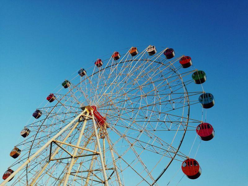 Amusement Park Ferris Wheel Arts Culture And Entertainment Clear Sky Amusement Park Ride Outdoors No People Day Sky