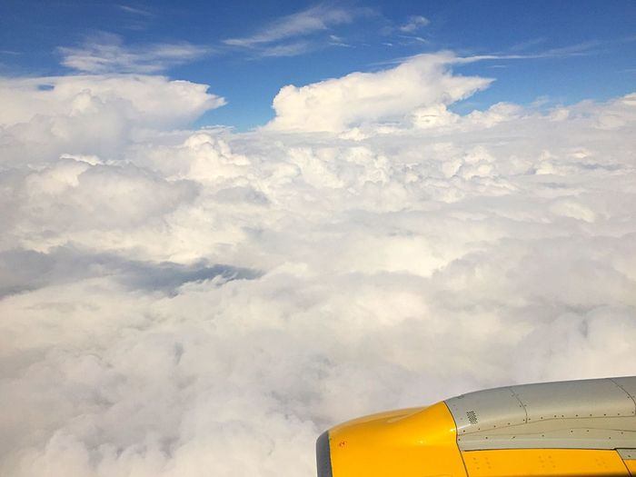 Yellow Sky And Clouds From An Airplane Window