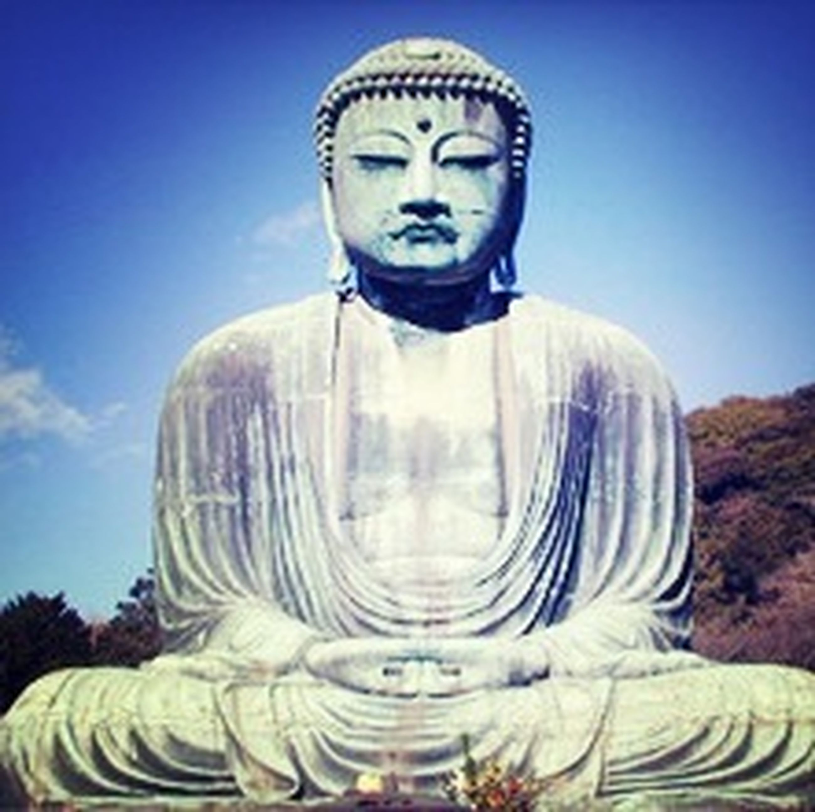 statue, human representation, sculpture, art and craft, art, creativity, buddha, religion, spirituality, low angle view, famous place, clear sky, travel destinations, carving - craft product, sky, travel, blue