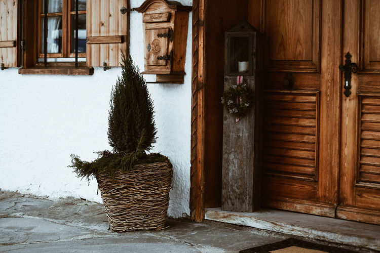 Wooden decor Wood - Material Door Entrance No People House Architecture Built Structure Plant Building Exterior Building Day Outdoors Nature Decoration Christmas Tree Snow Log Cabin Wooden Exterior Wooden Interior Wooden Architecture Architecture Wooden Decoration Door Decorations