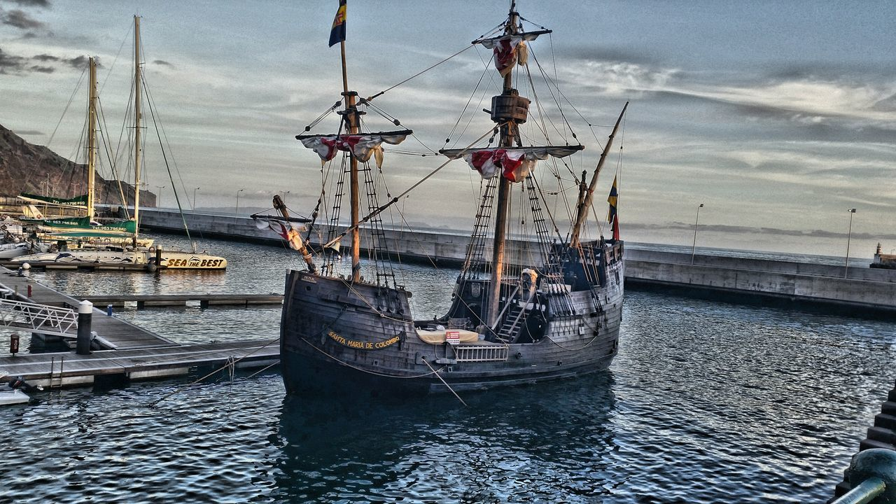 nautical vessel, transportation, mode of transport, water, boat, moored, mast, sky, sea, cloud - sky, day, sailboat, outdoors, harbor, no people, waterfront, ship, sailing ship, nature, travel destinations, sailing, tall ship, architecture