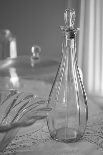 Close-up of glass bottle on table at home