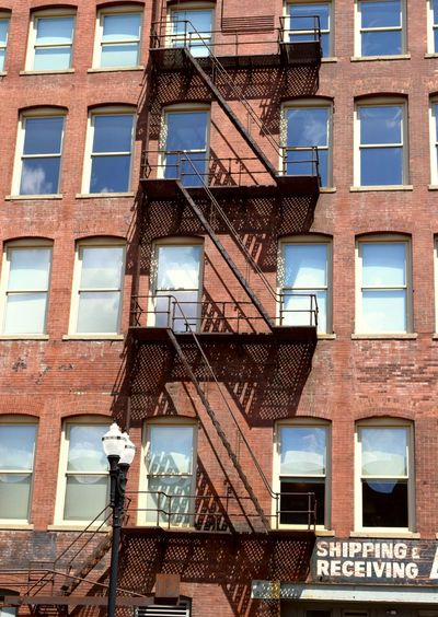Low angle view of fire escape on building during sunny day