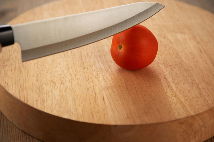 High angle view of strawberry on cutting board