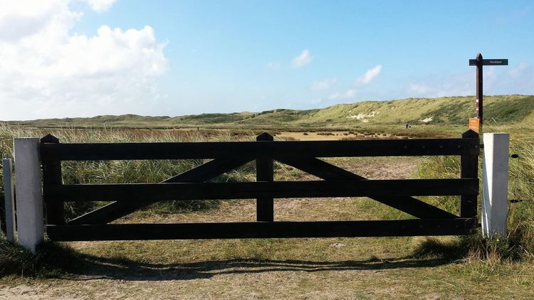 Behind this fence is an amazing path which brings through the dunes, moorland, mudflats, along sweet water, salt water and brackish water, from the north of the island (where I am) to the south for about 24km. You'll see oyster catcher, spoonbill, godwit and many more island birds.. TGI Fence Post Friday Come Walk With Me Landscape_Collection My Island