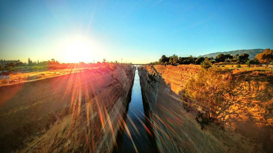 Korintho Tranquil Scene Landscape Lens Flare Scenics Dirt Road Greece Landscapes 2016 Picture Emiliano Perani Pelopponese Korinthos Bridge Over Water Majestic Sunsets Corinth Greece Bridge Tramonto Color Prospective Corinto Channel Greek Summer Canals And Waterways Mahi