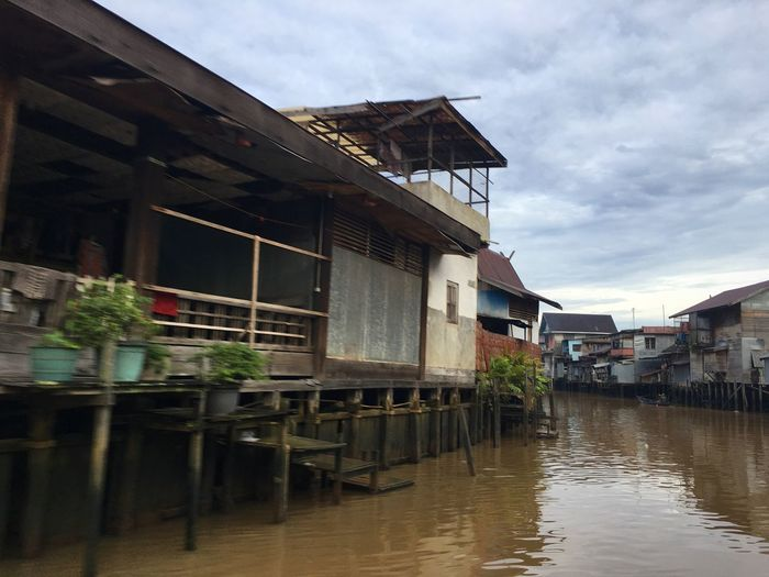 """Indonesia In My Eye"" Architecture Building Exterior Water Built Structure Sky Reflection Outdoors Table No People Day Sunday Morning Borneo Island Banjarmasin Iphone6splus Transportation IPhoneography Activity -Martapura River-"