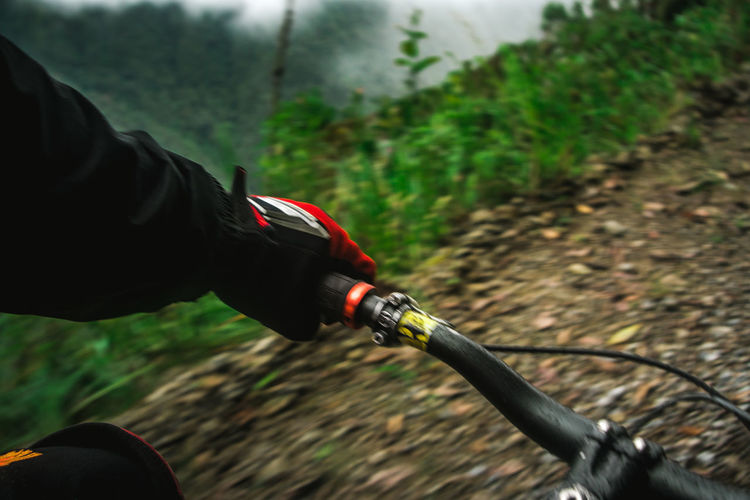 Cropped image of person cycling on mountain