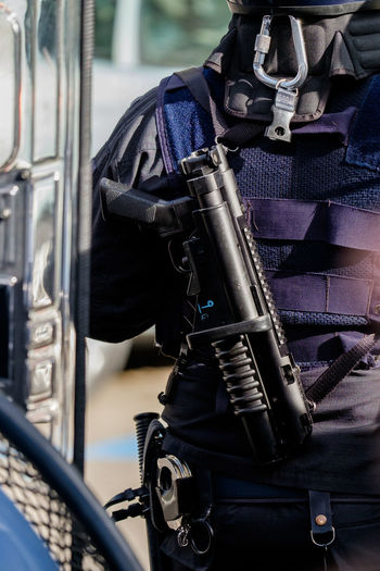 Midsection Of Police Officer With Gun
