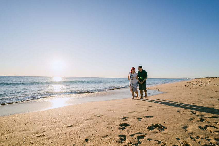 Couple on the beach Adult Adults Only Beach Bonding Clear Sky Enjoyment Full Length Heterosexual Couple Horizon Over Water Love Mature Adult Mature Couple Mature Men Mature Women Men Rear View Sand Sea Sky Sunlight Togetherness Two People Vacations Walking Women