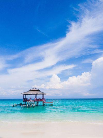 Gazebo On Beach Against Blue Sky