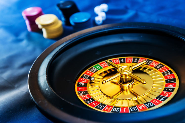 Gambling chips and dice with casino on table