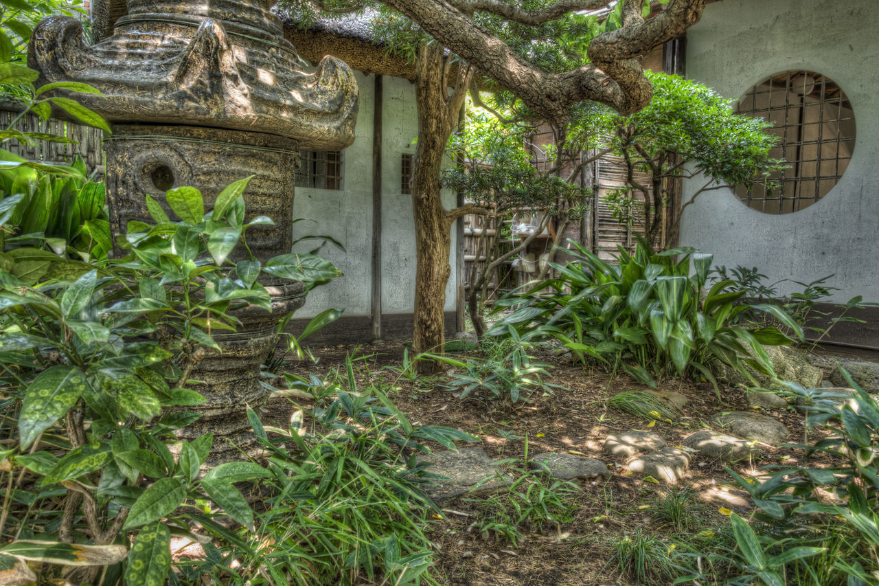 Stone Japanese Lantern In Garden
