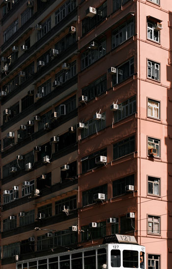 Architecture Hong Kong Shadows & Lights Apartment Architecture Backgrounds Building Building Exterior Built Structure Car City Day Land Vehicle Low Angle View Mode Of Transportation Motor Vehicle No People Outdoors Repetition Residential District Tramway Window The Architect - 2018 EyeEm Awards