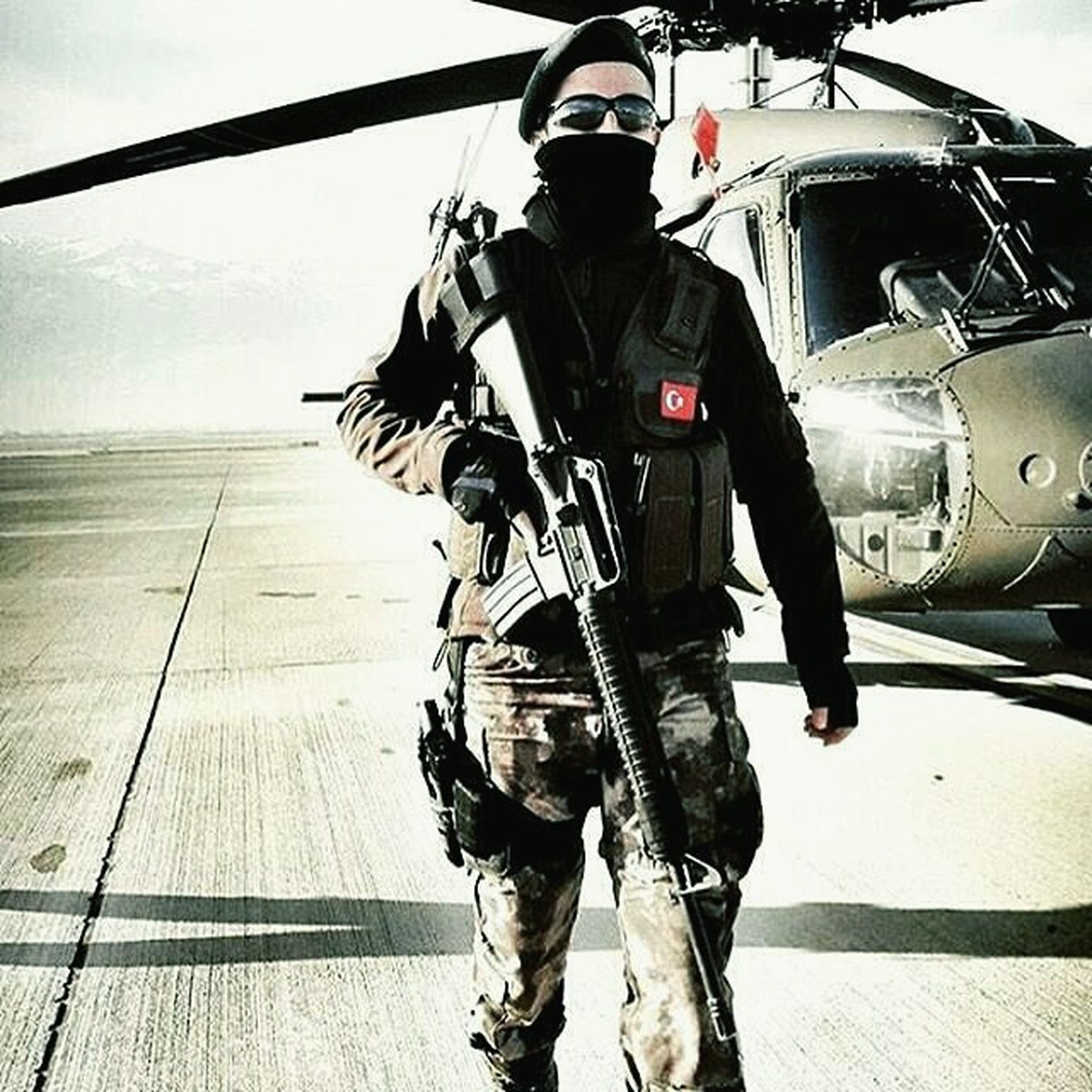 military, transportation, air vehicle, rear view, day, outdoors, military uniform, army, helicopter, army soldier, air force, pilot, headwear, men, one person, army helmet, adults only, adult, cockpit, people, camouflage clothing