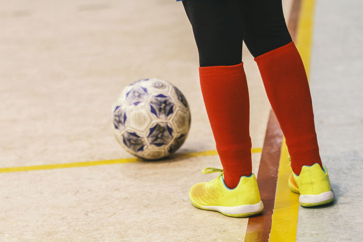 soccer / football Ball Close-up Competition Day Exercising Human Body Part Human Hand Human Leg Indoors  Kicking Low Section Match - Sport One Person Playing Real People Skill  Soccer Soccer Ball Soccer Field Soccer Player Soccer Shoe Soccer Uniform Sport Sports Uniform Standing